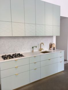Hey Yeh | Pimp Your Ikea w/ Superfront . Love the hint of blue and handles for an elegant kitchen | k i t c h e n