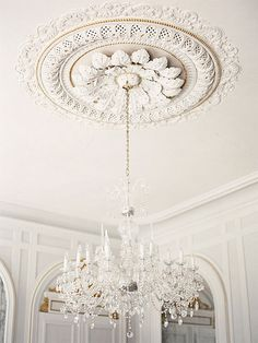 Beautiful Elaborate Victorian ceiling rose with a crystal chandelier hanging from it...x