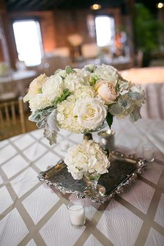 Blush and ivory rose and hydrangea centerpiece | Phindy Studios | Brides.com