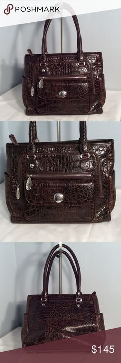 Stunning high Quality Brighton purse Brighton brown Mott crock leather purse with silver edge detail and woven leather handles. Very large wide opening to the inside with multi organizing pockets does include the original dust cover and is in excellent condition no damage Brighton Bags Shoulder Bags