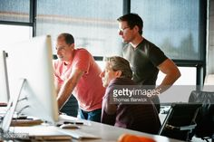 Stock Photo : Businessmen at computer in startup office