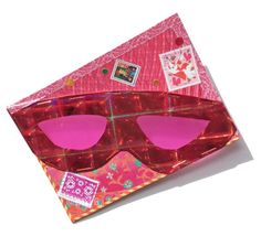Can mail art be used as sunglasses? The answer is yes!  This piece arrived for the Pink Mail Art show from Jackie Wygant.