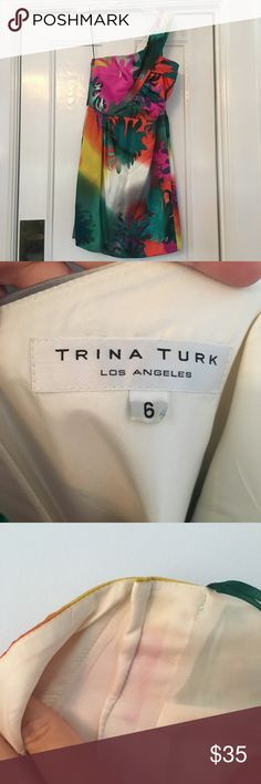 Trina Turk Dress This is a one shoulder Trina Turk dress size 6. As you can see in my pictures it was taken in about 1/2 an inch or so in the chest area. It's a great dress and worn one time. Trina Turk Dresses One Shoulder
