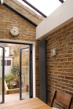 Green Tea Architects - Side Return Extension, Brockley, London Colour Brick Cosmetics say - This property's extension has been brick matched well but if thats not possible, for a variety of reasons, tint it so it does Vertical Radiators, Kitchen Diner Extension, Kitchen Extension, Exposed Brick Walls, Victorian Terrace, Glass Roof, House, New Homes, Brick