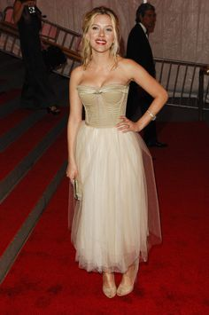A longer, flowy skirt is made super sexy with this corseted top for the Met Gala -- she looks like she's channeling tinker bell a little, but we love it! via StyleList
