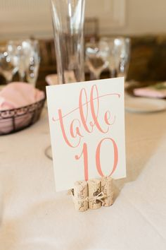 Wine cork + calligraphy table numbers: http://www.stylemepretty.com/virginia-weddings/leesburg/2016/01/21/pretty-pink-rustic-stone-tower-winery-wedding/ | Photography: Candice Adelle - http://candiceadelle.com/