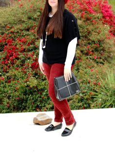 Inbetweenie winter style. How to style a red felt hat and red cords. Burgundy corduroy pants, black top, black accessories. Plus size winter wear. DYT T4. Dressing your truth type 4.
