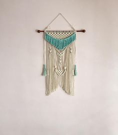 70s Macrame is back with a modern twist This gorgeous macrame wall hanging is made with natural rope cord. I have dip dyed the fringe and the tassels in Aqua dye. This all hangs on a bamboo rod It measures 23 wide and 32 long. This measurement is from the Top of the rod to the bottom