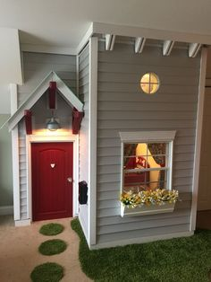 This is the adorable house that my husband built for our kids in our bonus room. We had a kick out in that room that we were not using so he made a little house. It is a one bedroom loft with full retro red pottery barn kitchen. The house is adorable and my husband, well he is amazing.: