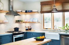 Dark kitchen cabinets with open shelves and woven window covering
