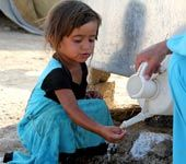 2 year old Amina washes her hands in a camp for Syrian refugees in Iraq Credit: © UNICEF/NYHQ2012-0879/Abdulmunem