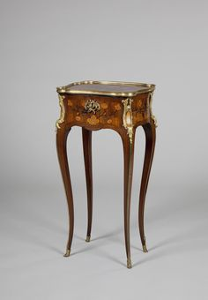 Small Table. Place of creation: France. Date: Middle of 18th Century. Material: wood and bronze. Technique: carved with marqueterie.
