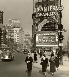 Time Square vintage photo. Camel cigarette, Planter's Peanuts and CocaCola billboards. New York City - 1936
