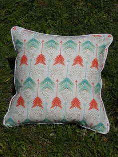 A personal favorite from my Etsy shop https://www.etsy.com/listing/235738323/arrow-pillow-red-green-and-white