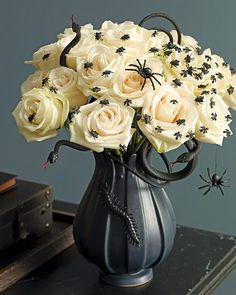 'Creepy Halloween floral display - love that you can remove the bugs the next day and just have pretty flowers. | martha stewart' from the web at 'https://i.pinimg.com/236x/01/41/bf/0141bfdc54e4fb67189cd707f293680f--white-roses-white-flowers.jpg'
