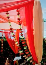 mandap - Flower strands around top side draping (probably would want different and less flowers / more spaced out? whatever matches those hanging in the back)