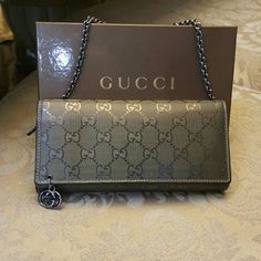 **Final markdown ** Gucci wallet clutch with chain Great condition normal wear. Olive color Gucci wallet clutch with chain. Comes with box. 100% Authentic   Reasonable offers welcome. Please use the offer button. Gucci Bags Clutches & Wristlets