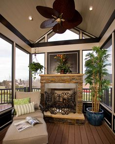A small reading porch complete with fireplace and TimberTech decking  Photos by Ray Strawbridge Commercial Photography
