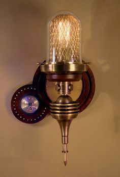 ~ Donovan Design Steampunk Wall Lamp  Not so keen on the plasma light, but I love the netted hurrican and exposed bulb element.