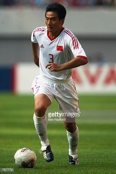 Pu Yang of China runs with the ball during the FIFA World Cup Finals 2002 Group C match between Turkey and China played at the Seoul World Cup...