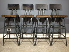 Set of  Reclaimed Wood Urban Industrial bar Stools with Steel Backs and a Scorched Finish -FAST SHIPPING -Modern Salvaged Barn Wood by UrbanWoodFurnishings on Etsy https://www.etsy.com/listing/166213298/set-of-reclaimed-wood-urban-industrial
