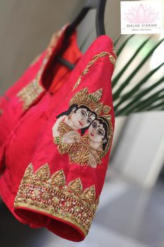 Krishna radha embellishments woven in the bridal blouse. Beautiful red color bridal designer blouse with Krishna and Radha design hand embroidery work on sleeve. Fancy Blouse Designs, Dress Neck Designs, Bridal Blouse Designs, Sleeve Designs, Blouse Neck Patterns, Mirror Work Blouse, Maggam Work Designs, Pattu Saree Blouse Designs, Designers