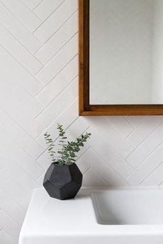 Modern bathroom features walls clad in a white herringbone tiles, EliteTile Retro x Polished Soho Subway Porcelain Field Tile in White, Bathroom Decor Masculine Bathroom, Minimal Bathroom, Masculine Home Decor, Attic Bathroom, Bathroom Interior, Bathroom Gray, Master Bathroom, Modern Bathroom Tile, White Bathrooms