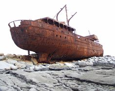Rusted shipwreck of the Plassey, near Inis Oírr, Aran islands, Ireland  | .Ireland, Shipwreck | 2 comments »    AddThis 	StumbleUpon 		digg 	    The cargo vessel Plassey was shipwrecked off Inis Oírr in the 1960s, and has since been thrown above high tide mark at Carraig na Finise on the island by strong Atlantic waves. The islanders rescued the entire crew from the stricken vessel using a breeches buoy-