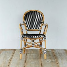 """Woven in crisp black and white for graphic appeal, this rattan chair makes a comfortable seat indoors and out.- Natural manao rattan, polyurethane (synthetic rattan)- Wipe clean with soft, dry towel; synthetic rattan may be washed with mild soap and water- Indoor or outdoor use- Seat: 18.1""""H, 17.9""""D - Imported31.7""""H, 22""""W, 24.6""""D"""