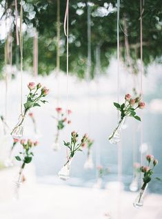 We have these little vases in our inventory. They would look precious hanging behind the ceremony site of most any venue. Let us help you with your wedding décor. https://www.facebook.com/atouchofnaturefloral