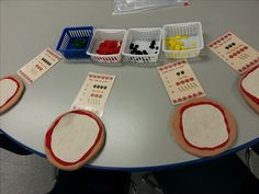 "Dramatic Play: Pizza game! Provide felt pizzas and ingredients. Encourage the students to ""read"" and follow the menu cards to put the correct ingredients and amounts on each pizza. Super Fun!!!"
