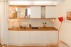 Kitchenette moderne dans un appartement de 20m2 par maéma architectes