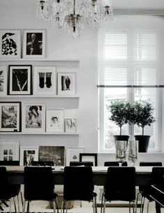 black and white office with photo wall