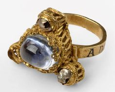 Papal Ring of Heinrich IV c. 1100.; cabochon sapphire with pearls in yellow gold.
