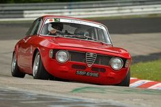 An Alfa Romeo Giulia GTA (or a clone) on the Nordschleife (The infamous North Loop of the Nurburgring. Alfa Bertone, Alfa Gta, Alfa Romeo Gta, Maserati, Ferrari, Alfa Romeo Junior, Touring, Alfa Romeo Giulia, Modified Cars