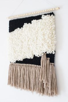 This woven wall hanging is a true eye catcher and will be perfect as your home wall decor, whether it be hung. The color palette is well balanced with soft tones of ivory, off white, beige and black. This piece is woven with wool, wool and alpaca and wool with silk. Colours are true