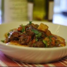 Venison is mixed with vegetables, tomato, cognac and herbs for a very different kind of stew. Serve over mashed potatoes or polenta. Healthy Milk, Healthy Cooking, Beef Recipes, Vegetarian Recipes, Healthy Recipes, Venison Stew, Cheese Ball Recipes, Famous Recipe, Chicken Thigh Recipes