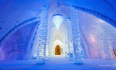 Frozen Palace of Snow and Carved Ice. Just north of Quebec City, Hôtel de Glace stands amid snow-covered hills like an icy citadel in a fairy tale. The hotel's domes and columns have been molded from 500 tons of ice and 15,000 tons of snow—the same materials used to carve the interior's sparkling chandeliers and one-of-a-kind sculptures. The structure is as intricate as a snowflake and as ephemeral: