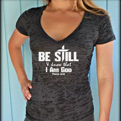 """This fabulous tee has an amazingly motivational bible verse printed on it, """"Be Still & Know That I am God. Psalm These sporty burnout v-neck t-shirts great for everyday use, running or lifting Christian Clothing, Christian Apparel, She Is Clothed, Workout Tank Tops, Graphic Shirts, Tee Design, Girls Shopping, Fit Women, V Neck T Shirt"""