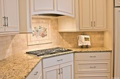 white counters with beige granite