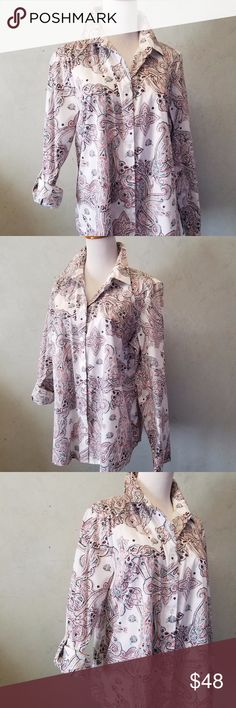 NWT Chico's button down shirt Brand new with tags Chico's button down shirt. The sleeve can be worn long or as a 3/4 sleeve. Chico's size 2 Chico's Tops Button Down Shirts