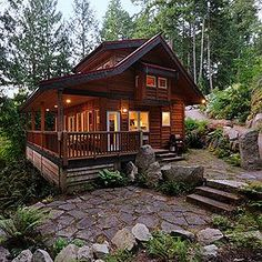Moon Dance Cabin, Pender Harbour. BC, Canada Everybody loves a covered veranda. The horizontal cedar siding gives the cabin a very rustic feel. I also like the flagstone patio. #LogCabinHomes