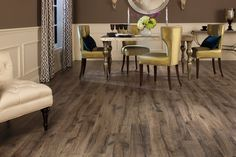 Laminate  Similar to vinyl flooring products, laminates are a budget-friendly flooring choice and are soft underfoot when compared to rigid flooring materials. They tend to be more moisture resistant than wood floors, but because they are not a solid material all the way through, they can't be refinished if damaged.