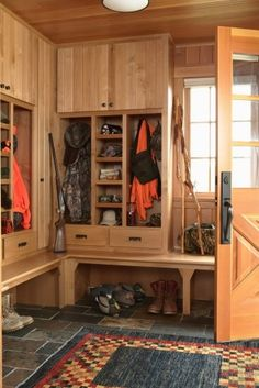 Mudroom with storage for hunting gear.