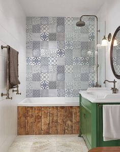 Moroccian tiles on the wall and a bathtube front made of rustic wood