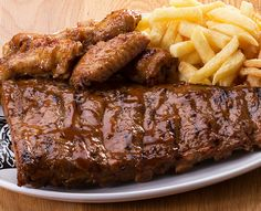 Try our famous ribs or one of the many items off our sizzling grill menu. Served with Spur-style crispy onion rings and chips OR a baked potato. Marinated Pork Ribs, Crispy Onions, Buffalo Wings, Wedding Menu, Grills, Baked Potato, Entrees, Sausage, Steak