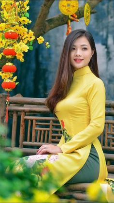 "The Vietnamese ""Ao Dai"", the long gown worn with trousers by Vietnamese women, has become the symbol of the Vietnamese feminine beauty, an. Beautiful Indian Actress, Beautiful Asian Women, Vietnam Costume, Moda China, Vietnam Girl, Vietnamese Dress, Ao Dai, Hottest Models, Traditional Dresses"