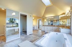 Spacious Master Bathroom with Attached Closets