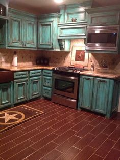 Turq and brown kitchen. I love this however im unsure if its too much turquoise or not, or if id grow old of it. turquoise kitchen cabinets kitchen makeover kitchen remodel kitchen upgrade