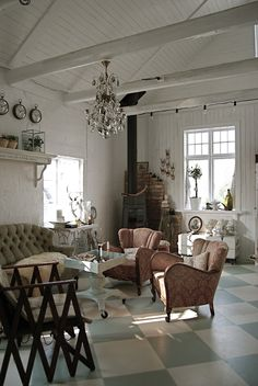 The floor tiles and chandelier really pull this room together.